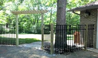 aluminum ornamental fence on wood posts with gate arbor 1